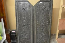A pair of large cast-iron panels in the Adam taste, rectangular, each centred by a female
