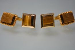 A pair of gentleman's 9ct gold cufflinks, set with unpolished stones; together with a pair of