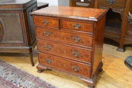 A George II style burr walnut and elm chest of drawers, the quarter veneered, crossbanded, moulded