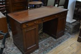 A 19th century mahogany pedestal desk, the moulded ledge back top above three frieze drawers over