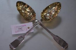 A pair of William IV silver berry spoons, London 1832 each gilt bowl chased with a pineapple, fiddle