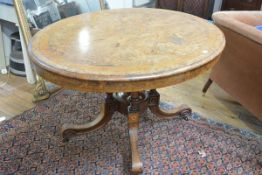 A Victorian inlaid burr walnut loo table, the quarter veneered crossbanded oval top on a four