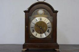 A mahogany cased bracket clock in 18th century style, by Elliott, retailed by Hamilton & Inches, the
