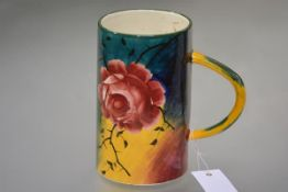 "A large Wemyss Pottery ""Jazzy"" ware tankard, of tapering cylindrical form, decorated with pink"