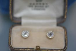 A pair of gentleman's diamond-set enamel collar studs, c. 1920, each centred by a brilliant-cut
