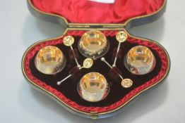 A cased set of four late Victorian salts, Birmingham 1890, each of shaped circular form, on ball
