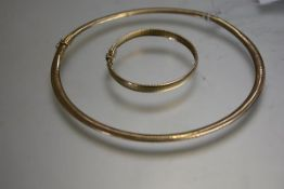 A 9ct yellow gold necklace, of articulated panels together with a bracelet en suite ,with box snap