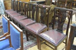 A set of eight mahogany dining chairs in the Georgian taste, c. 1900, each with pierced baluster