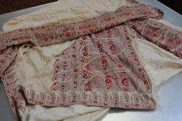 A 19th century woven paisley shawl, the fine wool cream ground within narrow borders of