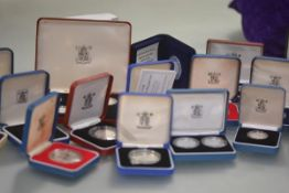 A group of Royal Mint cased silver proof coins, mostly Royal Commemorative, Elizabeth II, various