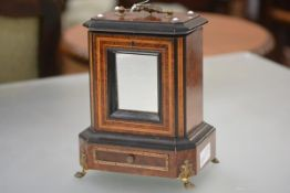An unusual 19th century part-ebonised, satinwood-inlaid amboyna novelty musical humidor, the