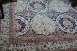 An Indo-Persian small carpet, the centre panel with allover interlocking scalloped floral medallions