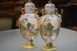 A pair of large hand-painted named view pottery vases and covers by William Yale, probably Copeland,