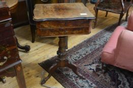 A mid-Victorian walnut work table, the quarter veneered hinged top with moulded scalloped rim