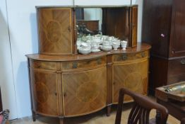 A striking 19th century satinwood inlaid mahogany sideboard, c. 1820/30, of serpentine form, the