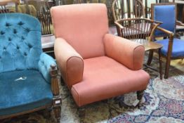 A Victorian mahogany framed gentleman's armchair, with upholstered back and arms, raised on turned