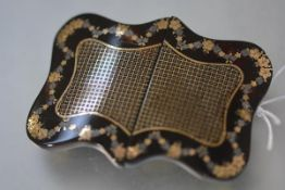 A pique work tortoiseshell buckle, c. 1900, of rectangular cartouche form, centred by a chequered