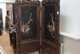 A large Japanese lacquer two-fold screen, Meiji period, the twin panels each decorated in high