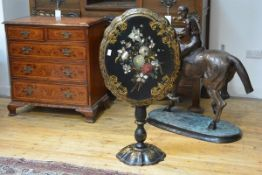 A 19th century tilt-top papier mache occasional table, the oval top with scalloped rim and painted