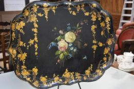A large Victorian gilt-highlighted painted papier mache tray, of rectangular form, with scalloped
