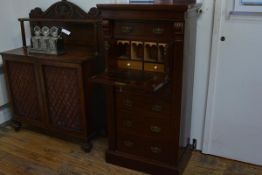 A 19th century mahogany Wellington secretaire chest, of characteristic form, the top drawer above