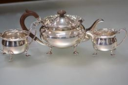 A George V silver three piece tea service, Sheffield 1930, each piece of bellied form, with