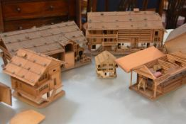 An unusual group of five late 19th/early 20th century wooden models of Alpine chalet buildings