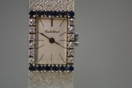 Bueche Girod, a lady's diamond and sapphire mounted 9ct white gold cocktail watch, the rectangular