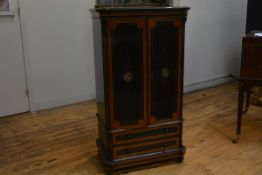 An amboyna-crossbanded ebonised side or music cabinet, third quarter of the 19th century, the