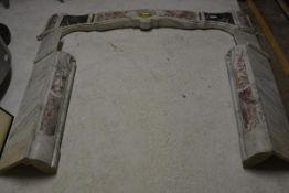 A Louis XV Provincial style variegated marble chimneypiece, probably 19th century, the serpentine