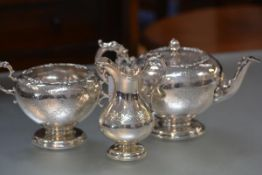 A Victorian Scottish silver matched three piece tea service, J. McKay, Edinburgh 1857 and 1858,