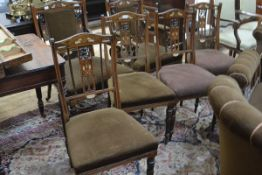 A set of four Edwardian inlaid rosewood drawing room chairs, en suite with the preceding lots.