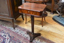 A Regency rosewood and mahogany work table, the rectangular hinged top with cut-off corners