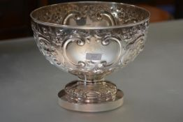 A large Victorian silver punch bowl, Walter & John Barnard, London 1882, chased with c-scrolls and