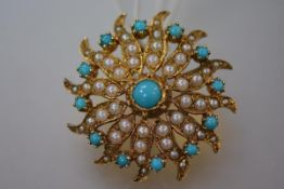 An early 20th century 9ct gold seed pearl and turquoise brooch, of stylised flowerhead form, centred