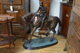 A very large equestrian bronze, 20th century, of horse and jockey in Edwardian style, the horse with