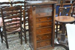 A rosewood Wellington chest, second quarter of the 19th century, of characteristic form, with