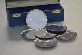 A cased set of six silver coasters, Birmingham 1998, each circular. Diameter 7.5cm