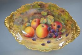 A Royal Worcester fruit-painted comport painted by Lockyer, of oval form, on a circular pedestal