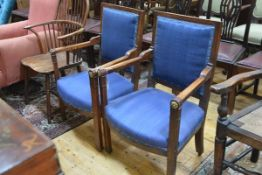 A pair of early 19th century mahogany fauteuils in the Empire taste, each with square upholstered