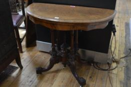 A Victorian inlaid walnut demilune foldover card table, third quarter of the 19th century, the top