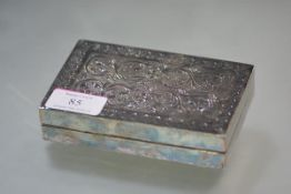 A Middle Eastern silver cigarette box, with bands of scroll and geometric engraving, bearing a