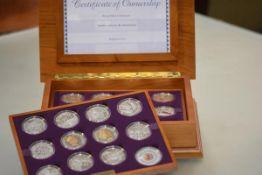 A Royal Mint Queen Elizabeth II Golden Jubilee silver proof coin set, twenty-four silver and