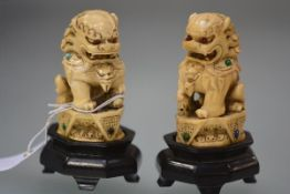 A pair of Chinese carved ivory models of Dogs of Fo, late 19th century, each with intricately carved