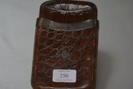 An Edwardian silver-mounted crocodile cigar case, London 1903, mounted to one side with the crest in
