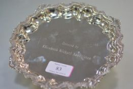 An Egyptian silver card tray in the Georgian taste, with shell-cast scalloped rim, engraved to the