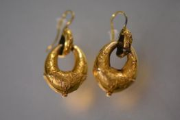 A pair of late Victorian yellow metal shaped hoop earrings, each with wirework decoration and fish