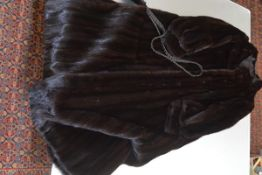 A lady's vintage full length dark mink coat, with shallow collar, tapering sleeves ending in