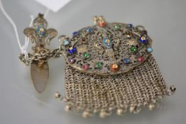 A late 19th century enamel and glass cabochon mounted white metal chatelaine purse, the mesh purse