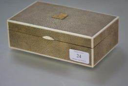 A 1920's ivory-mounted shagreen cigarette box, the cover mounted with a gilt plaque named for Burg